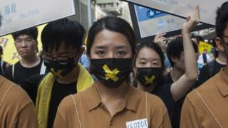 Students protesting political persecution march through the streets during the annual pro-democracy rally, Wan Chai, Hong Kong, China, 01 July 2018.