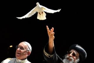 Pope Francis (l) and Coptic Pope Tawadros II, who releases a dove in Bari, Italy - Saturday 7 July 2018