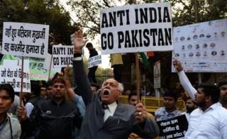 A file picture taken on February 17, 2016 shows Indian activists shouting slogans against Jawaharlal Nehru University (JNU) and the late Kashmiri separatist Mohammed Afzal Guru at a protest outside the university in New Delhi.