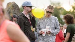 Festivalgoer inhales nitrous oxide