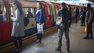 Passengers at Canning Town underground station in east London
