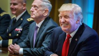 US President Donald Trump smiles as Defense Secretary James Mattis (C) looks on during a meeting with senior military leaders in the Cabinet Room of the White House on October 5, 2017