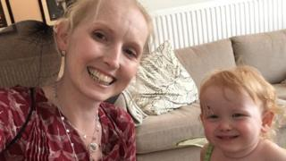 Jo Daniels, who depends on male blood donors to keep her sight, posing with her daughter