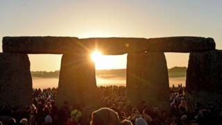Visitors celebrate summer solstice and the dawn of the longest day of the year at Stonehenge on June 21, 2019 in Amesbury, England.