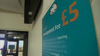 Sign at Newquay Airport informing passengers of the £5 Airport Development Fee