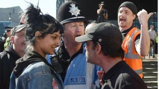 "A viral photo of a woman smiling at an English Defence League (EDL) protester in Birmingham was snapped after she stepped in to defend a ""fellow Brummie"", she has told the BBC."