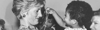 Princess Diana with an HIV positive child in Brazil in 1991