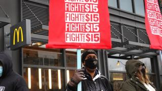 Demonstrators participate in a protest outside of McDonald's corporate headquarters on January 15, 2021 in Chicago, Illinois. The protest was part of a nationwide effort calling for minimum wage to be raised to $15-per-hour