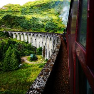 Jacobite Steam train heading over the Glenfinnan Viaduct