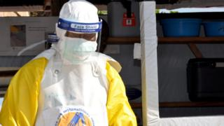 A man in a defensive gear against Ebola at a medicine center in Beni