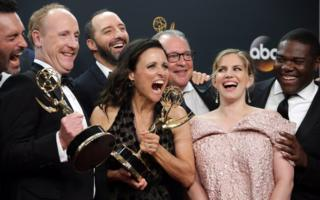 Julia Louis-Dreyfus (centre), winner of the Best Actress in a Comedy Series Award, as well as Outstanding Comedy Series Award for Veep, poses with the cast