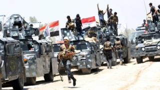 Iraqi security forces gather near Falluja, Iraq, May 31, 2016