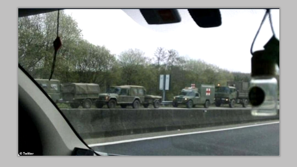 Military vehicles on the side of the road