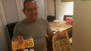 Paul Cooper with two editions of The Beano
