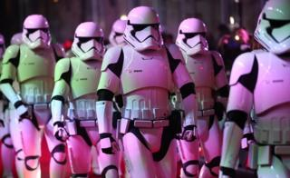 Actors dressed as stormtroopers arrive for a film premiere.
