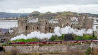 Galatea passing along the north Wales coast and steaming past Conwy Castle