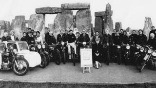 Photo from 1993 of a group of bikers at the monument