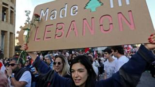 Lebanese demonstrators take part in a civilian Independence Day parade in Beirut's Martyr Square on November 22, 2019,