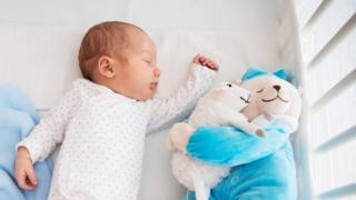 Baby sleeping with teddy