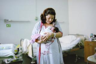 Roxana breastfeeding in the specialist maternity clinic.