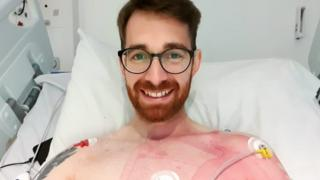 Dean Lushington in his hospital bed