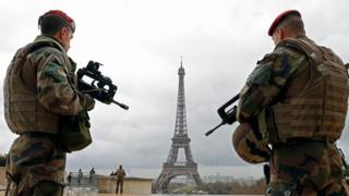 French army paratroopers patrol near the Eiffel tower in Paris, France, March 30, 2016