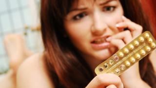 Mujer con la píldora.