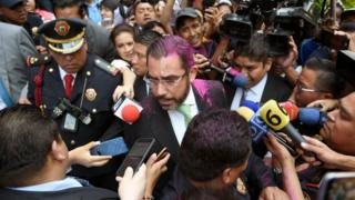 Mexico's security minister Jesus Orta was sprayed with pink glitter during the protests