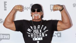 Hogan posing for photographers