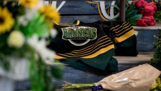 Memorial shows a Broncos shirt on a memorial in Humboldt