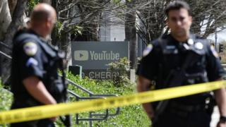 Police officers and crime scene tape are seen at Youtube headquarters