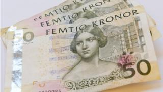 A small pile of old 50-krona notes