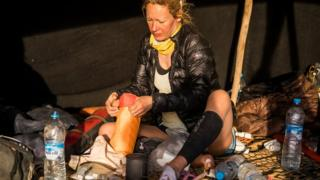 Sophie Raworth taping her feet before stage four of the Marathon des Sables