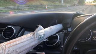 Pole embedded in dashboard
