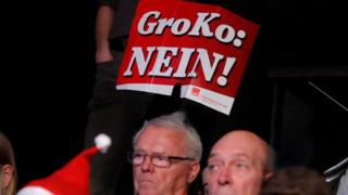 People protest during the SPD's party congress in Bonn, Germany