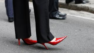 Woman wearing high heeled shoes