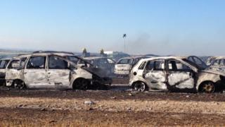 Burnt-out vehicles at Boomtown