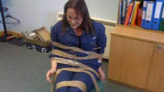 DeeAnn Fitzpatrick claims she was taped to a chair and gagged as a warning