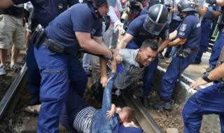 Hungarian police detain migrants at the railway station in the town of Bicske, Hungary, on 3 September, 2015.