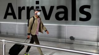 Man arriving at Heathrow airport