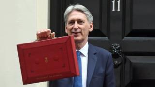 Philip Hammond carrying the budget box