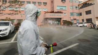 A worker disinfects the streets in Cheongdo, South Korea. Photo: 21 February 2020