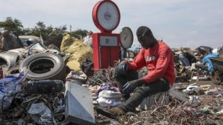 A man sorts through electronic waste at the Agbogbloshi electronic waste site in Accra, Ghana - Monday 27 August 2018