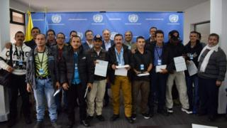 UN Secretary General's Special Representative for Colombia and Head of the UN Mission to Colombia, Jean Arnault (C), Revolutionary Armed Forces of Colombia (FARC) member Marco Calarca (R) and other members of the FARC