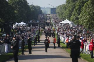 Police offers and spectators gather on the Long Walk ahead of the wedding of Prince Harry and Meghan Markle.