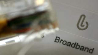 Close up of a broadband router and cable