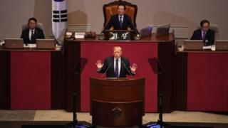 US President Donald Trump (C) addresses the National Assembly in Seoul on November 8, 2017.