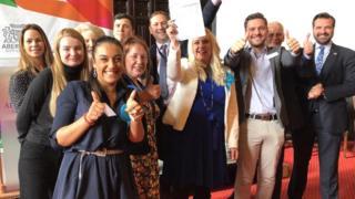 Sarah Cross (centre with paper) celebrates
