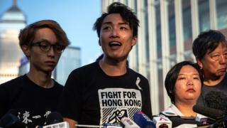 A member of Civil Human Rights Front Jimmy Sham (C) with other members speak during a news conference, next to the Legislative Council building, in Hong Kong, China, 15 June 2019