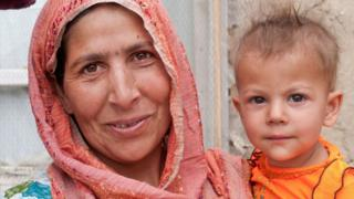 An Afghan woman and her child